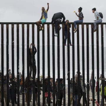 Tensions simmer in Mexico as asylum seekers wait at border