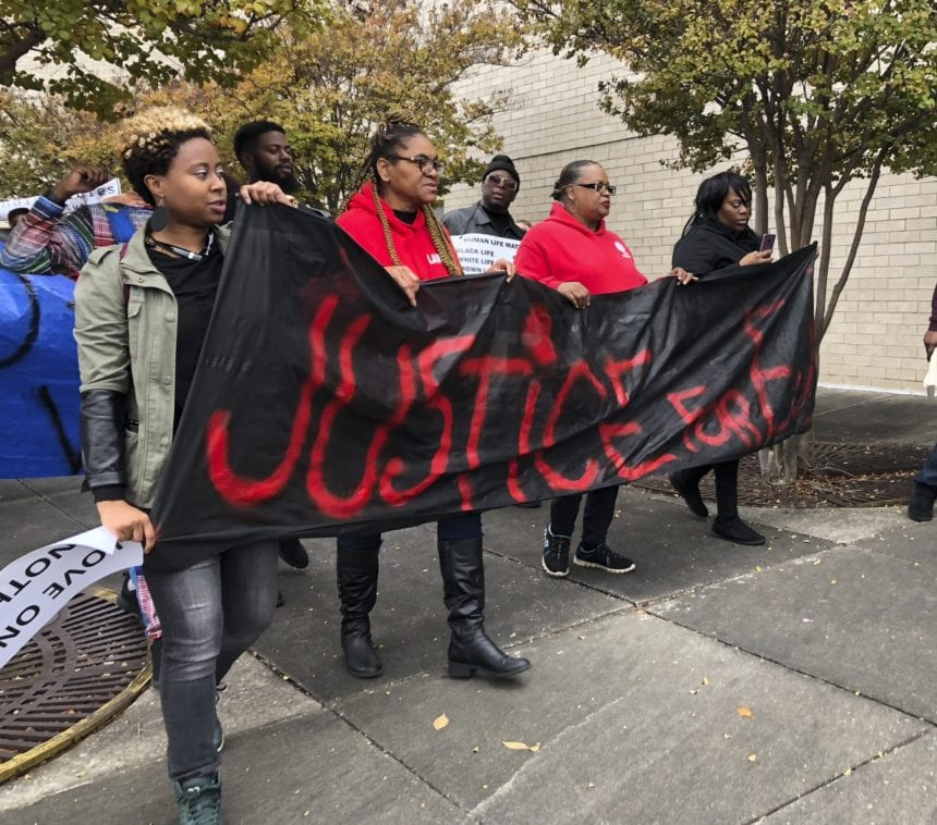 Calls for justice during funeral of black man killed at mall