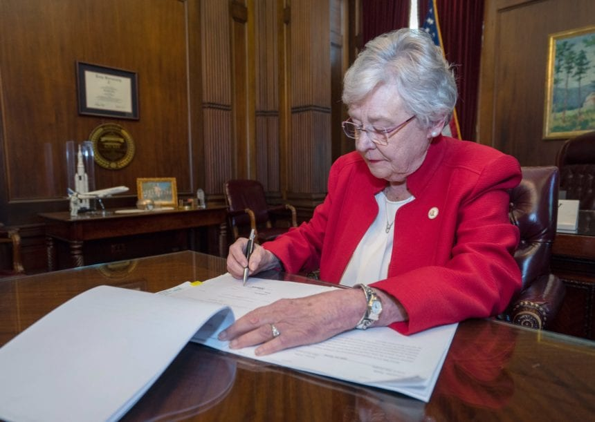 Ivey signs abortion ban; opponents vow swift legal action