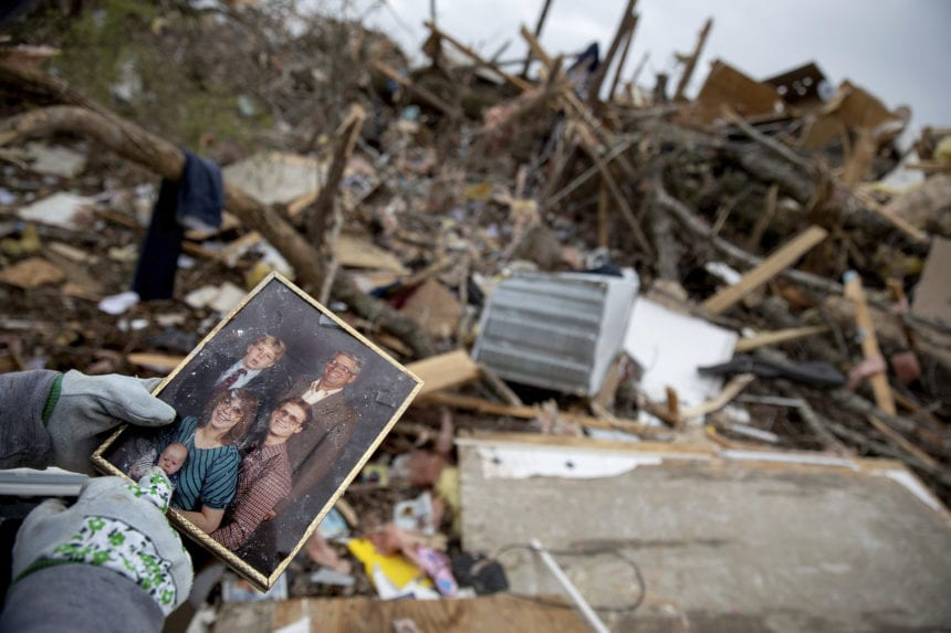 Amid the wreckage, a hunt for keepsakes of tornado victims