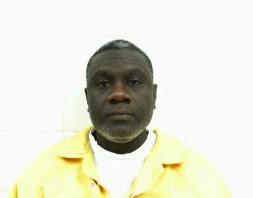 Wife defends Alabama man charged in '99 double killing