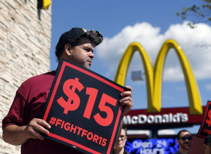 Court says workers can't sue over blocked minimum wage boost