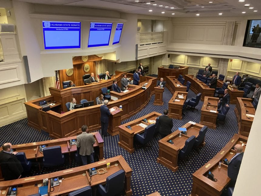Amid prayers and protective gear, Legislature postpones session