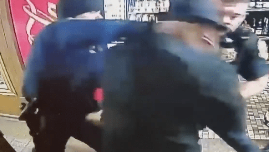 Black store owner reports robbery, gets punched by officer