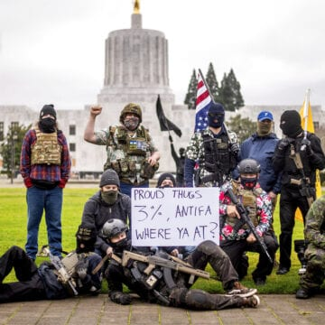 Heavily fortified statehouses around US see small protests